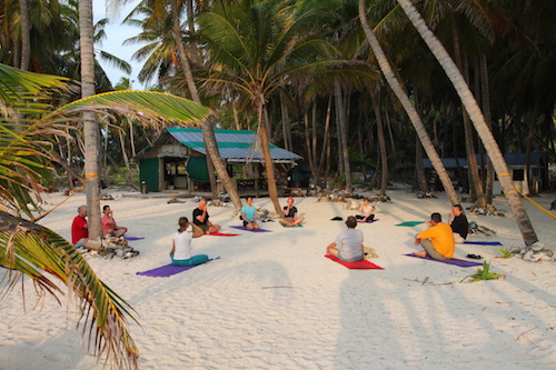 Sunrise yoga at Lighthouse Reef