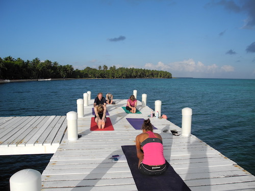 Yoga on the dock at Half Moon Caye, Belize
