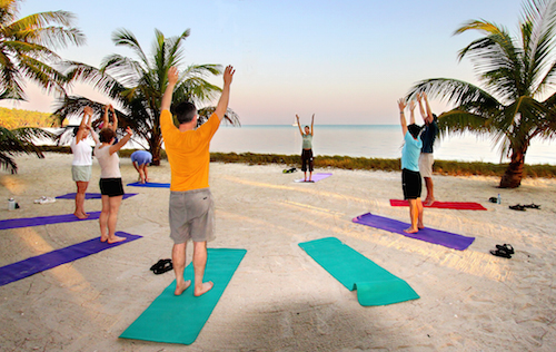 Sunrise yoga at Glovers Reef