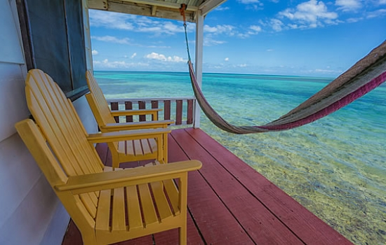 Tobacco Caye Paradise - Cabanas over the water