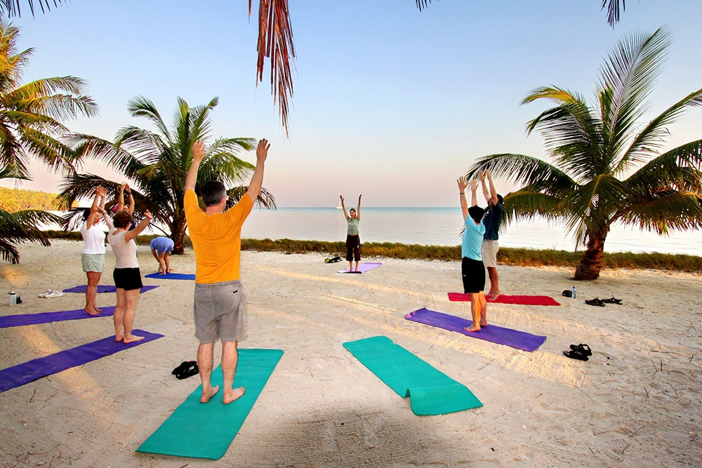 Sunrise yoga at the Glover's Reef Basecamp